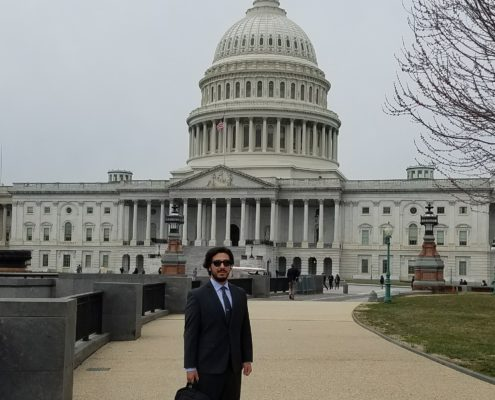 David Gonzalez stands in front of the U.S. Capitol building after meeting with congressional staffers in March 2018.