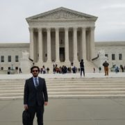 Gonzalez in front of the U.S. Supreme Court building.