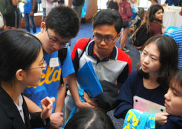Zhao Li (left), a teacher-scholar in Chemistry & Biochemistry, talks with first-year Physical Sciences students at the 2018 Welcome to Physical Sciences event reception