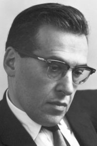 A black and white photo of Julian Schwinger, Nobel Prize winner in physics and professor at UCLA.