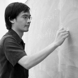 Terence Tao, professor of mathematics at UCLA, writes on a chalkboard.