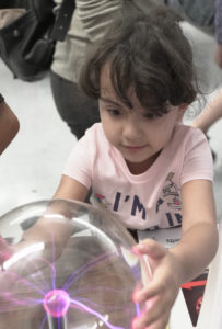 Small child at Exploring Your Universe free science event in November 2018.